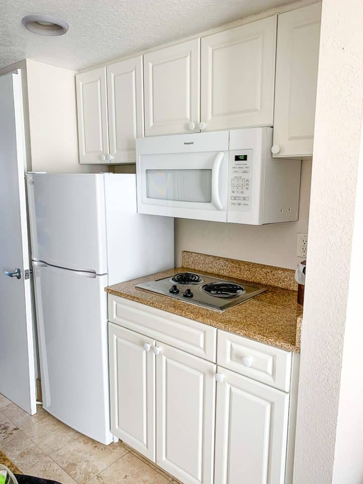 white kitchenette in hotel room suite