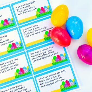 a sheet of paper with Easter egg scavenger hunt clues and plastic eggs beside it
